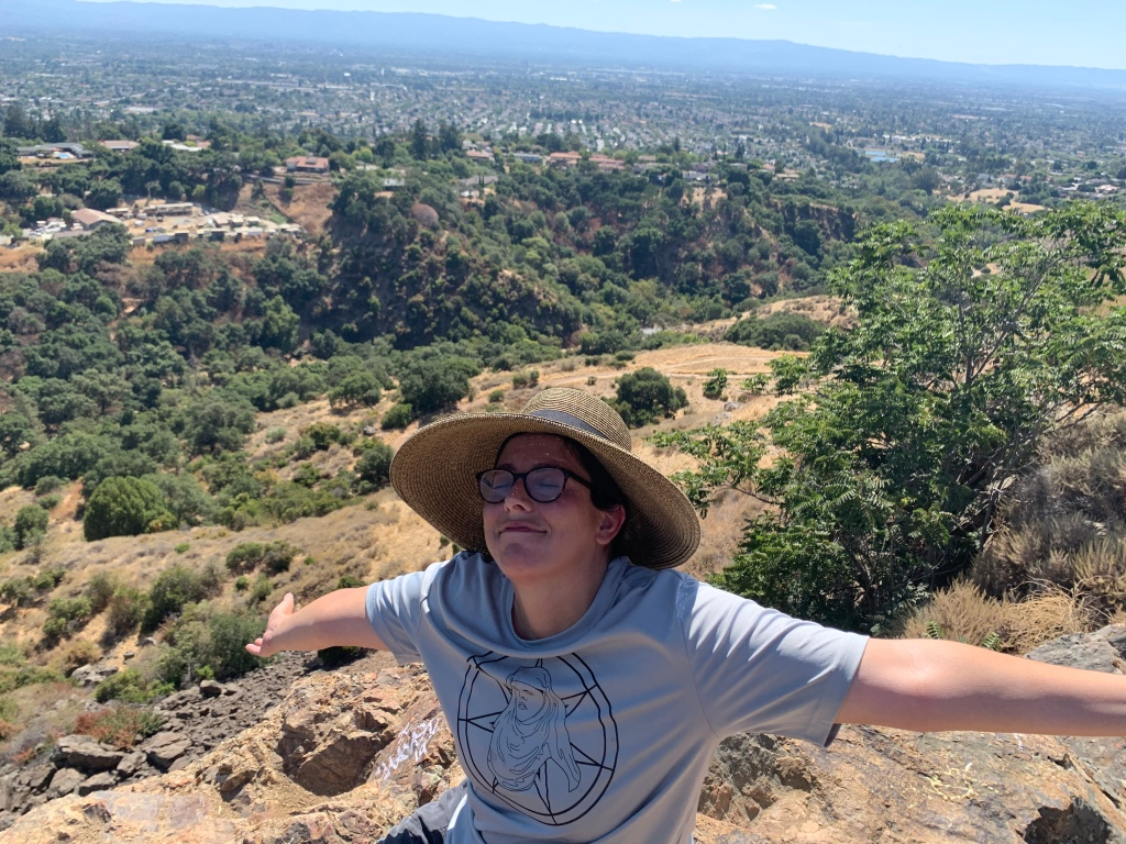 The view of San Jose from Alum Rock Park's Eagle Rock, with an exhausted and relieved Liz in her Shame Nun jersey in the foreground.